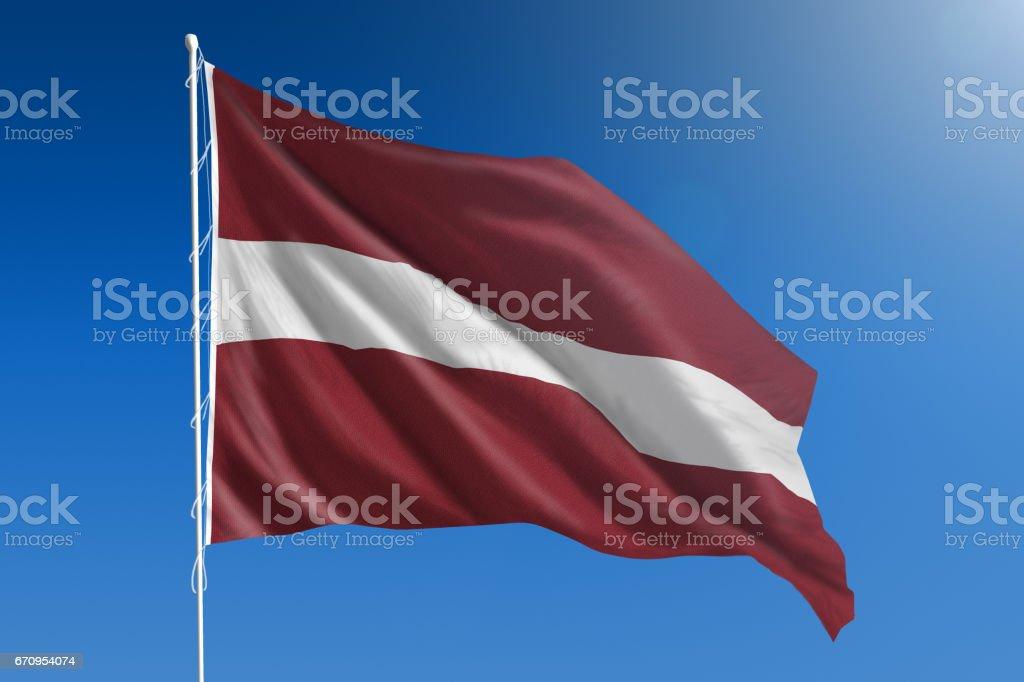 National flag of Latvia on clear blue sky stock photo