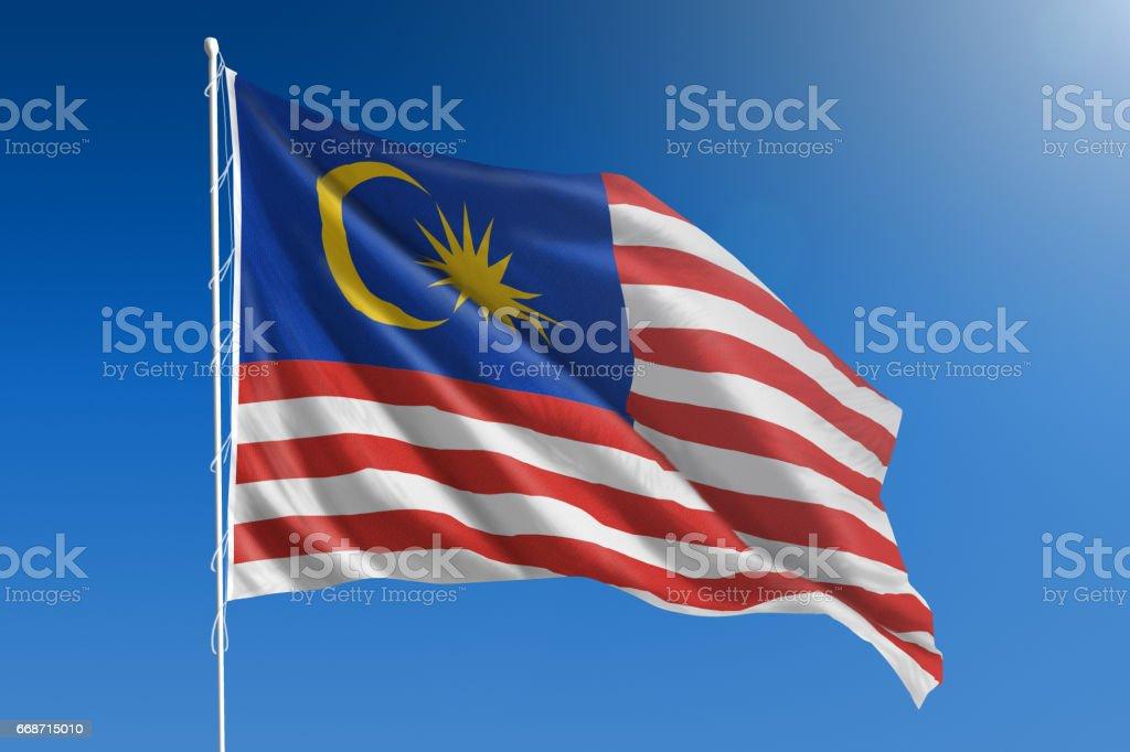 Bandeira nacional da Malásia no claro céu azul - foto de acervo