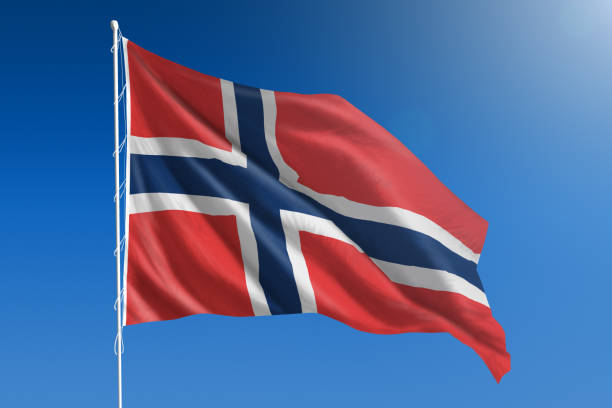 National flag of Norway on clear blue sky - fotografia de stock