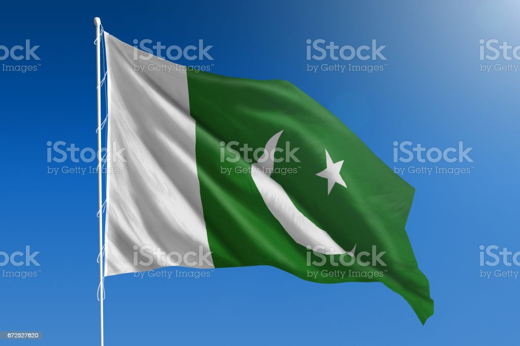National flag of Pakistan on clear blue sky stock photo