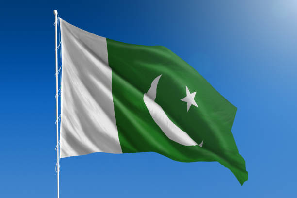 national flag of pakistan on clear blue sky - pakistani flag stock photos and pictures