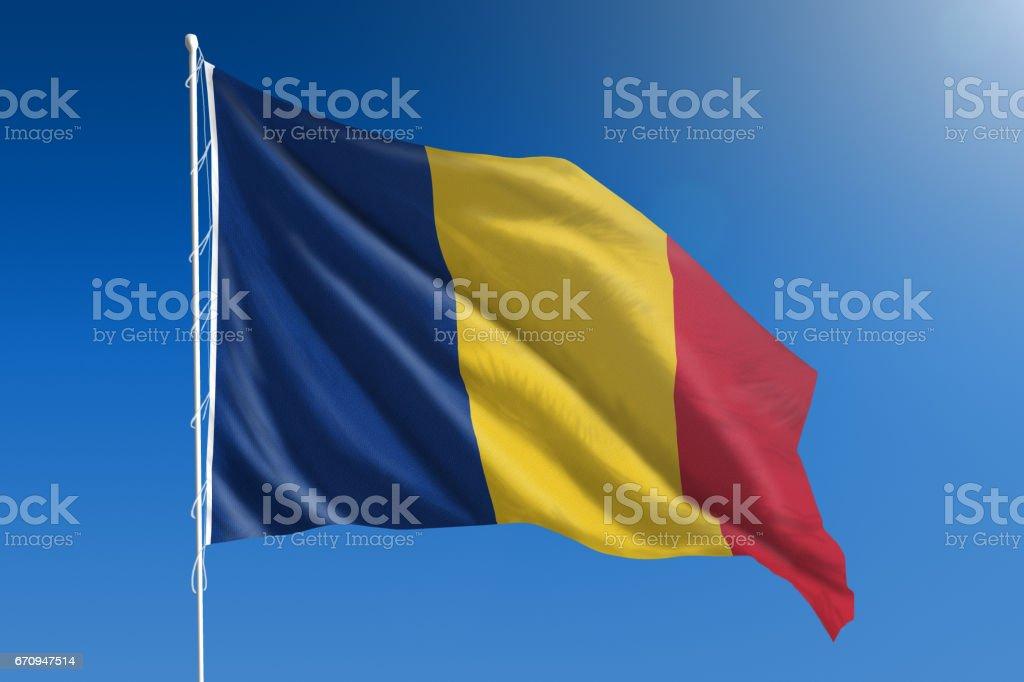 National flag of Romania on clear blue sky stock photo