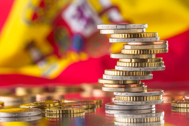 National flag of spain and euro coins - concept. Euro coins. Euro money. Euro currency stock photo