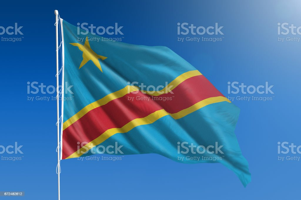 National flag of the Democratic Republic of the Congo on clear blue sky stock photo
