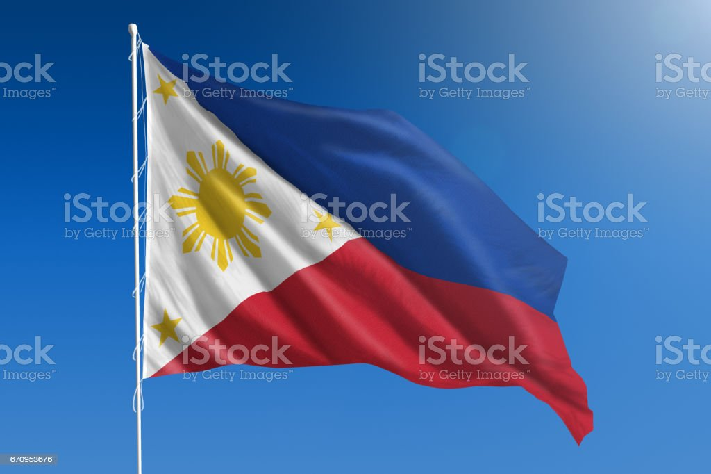 National flag of the Philippines on clear blue sky stock photo