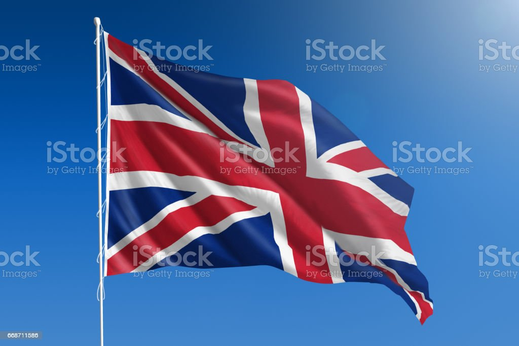 National flag of United Kingdom on clear blue sky stock photo