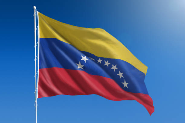 national flag of venezuela on clear blue sky - venezuelan flag stock photos and pictures