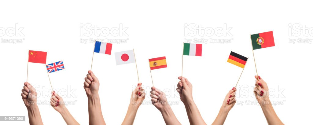 National flags in hands National flags of Germany, England, Italia, Japan, China Spain, France, Portugal in hands. Language studying concept on white background Adult Stock Photo