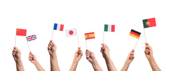 National flags in hands National flags of Germany, England, Italia, Japan, China Spain, France, Portugal in hands. Language studying concept on white background national flag stock pictures, royalty-free photos & images