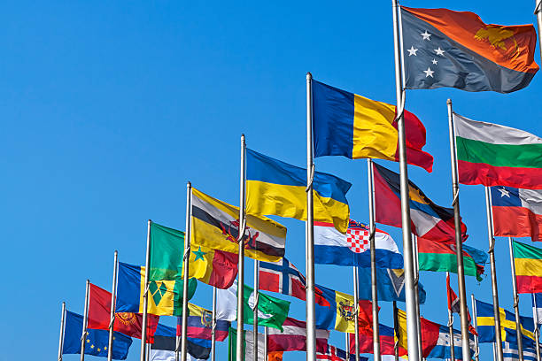 National flags of different country Different countries flags united together against blue sky national flag stock pictures, royalty-free photos & images