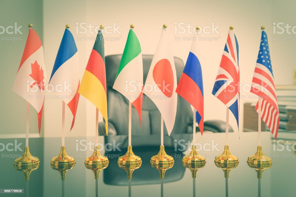 National flags of G8 or group of eight major highly industrialized countries i.e Canada, France, Germany, Italy, Japan, Russia, UK, USA stock photo