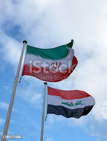 National flags of Iran and Iraq waving in the wind