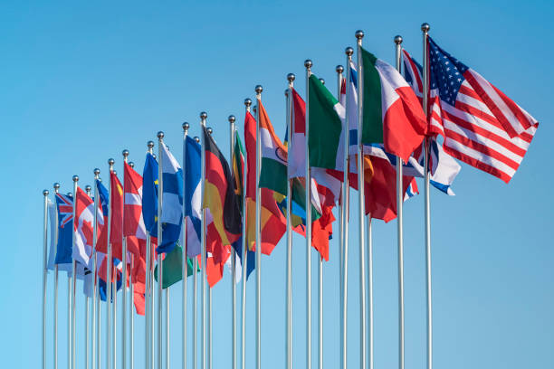 national flags national flags of various countries flying in the wind diplomacy stock pictures, royalty-free photos & images