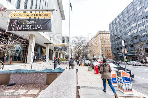 istock National Geographic Museum sign, entrance with people walking by street and building 968446182