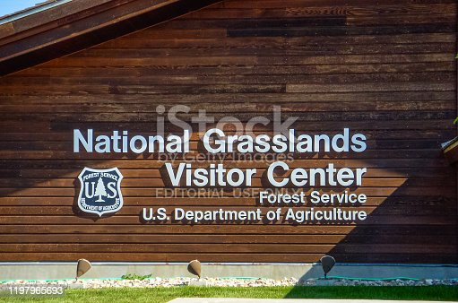The visitor's center sign of National Grasslands Park in the high plains of North America in the US state of South Dakota.