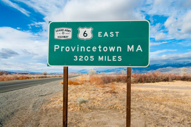 National Highway Origin Sign A road sign marks the western origin of The Grand Army of the Republic Highway (US Route 6) as it emerges from Bishop, CA and extends eastward to Provincetown, MA. provincetown stock pictures, royalty-free photos & images