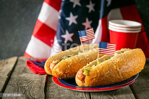 470765518 istock photo USA national holiday Labor Day, Memorial Day, Flag Day, 4th of July - hot dogs with ketchup and mustard on wood background 1219124346