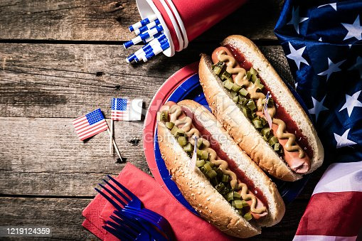 470765518 istock photo USA national holiday Labor Day, Memorial Day, Flag Day, 4th of July - hot dogs with ketchup and mustard on wood background 1219124359