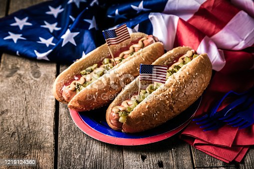 470765518 istock photo USA national holiday Labor Day, Memorial Day, Flag Day, 4th of July - hot dogs with ketchup and mustard on wood background 1219124360