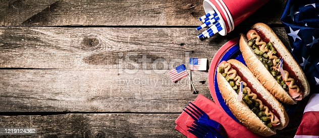 470765518 istock photo USA national holiday Labor Day, Memorial Day, Flag Day, 4th of July - hot dogs with ketchup and mustard on wood background 1219124362