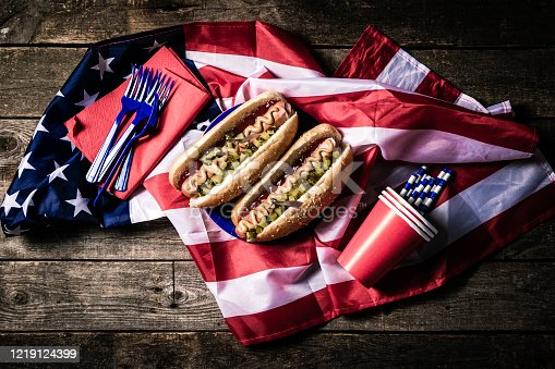 470765518 istock photo USA national holiday Labor Day, Memorial Day, Flag Day, 4th of July - hot dogs with ketchup and mustard on wood background 1219124399