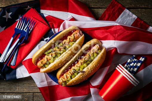 470765518 istock photo USA national holiday Labor Day, Memorial Day, Flag Day, 4th of July - hot dogs with ketchup and mustard on wood background 1219124401