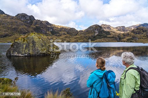 Mature women and men enjoying the Landscape of National park Las Cajas Mountains in Ecuador close to Cuenca city on 3850 altitude.