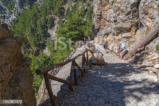 istock National Park of Samaria, Grecce, island Crete. Gorge Samaria. Road leading down. Itinerary for tourists. 1042901372