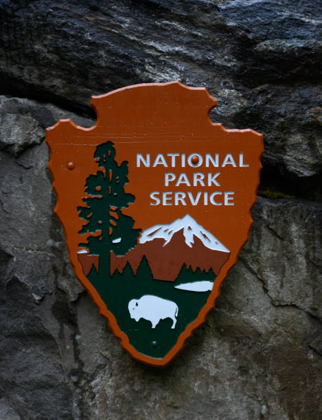 National Park Service Logo Hangs on Stone Wall stock photo