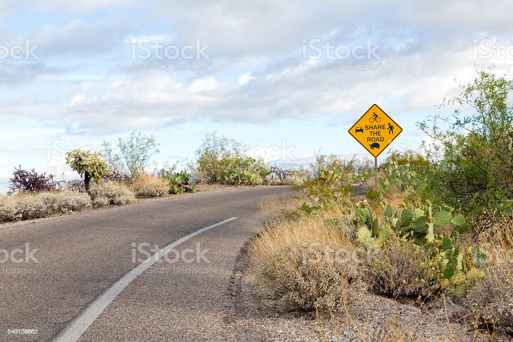 National park shared road usages sign stock photo
