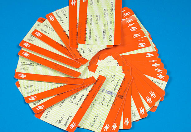 National Rail tickets - British travel Durham, England - December 17, 2012: these train tickets were printed at an automatic vending machine at Durham station. They are mostly tickets for the Durham-Newcastle journey. They were photographed on blue paper in my house. train ticket stock pictures, royalty-free photos & images