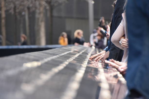 National September 11 Memorial in Manhattan, People touch the names of loved ones stock photo