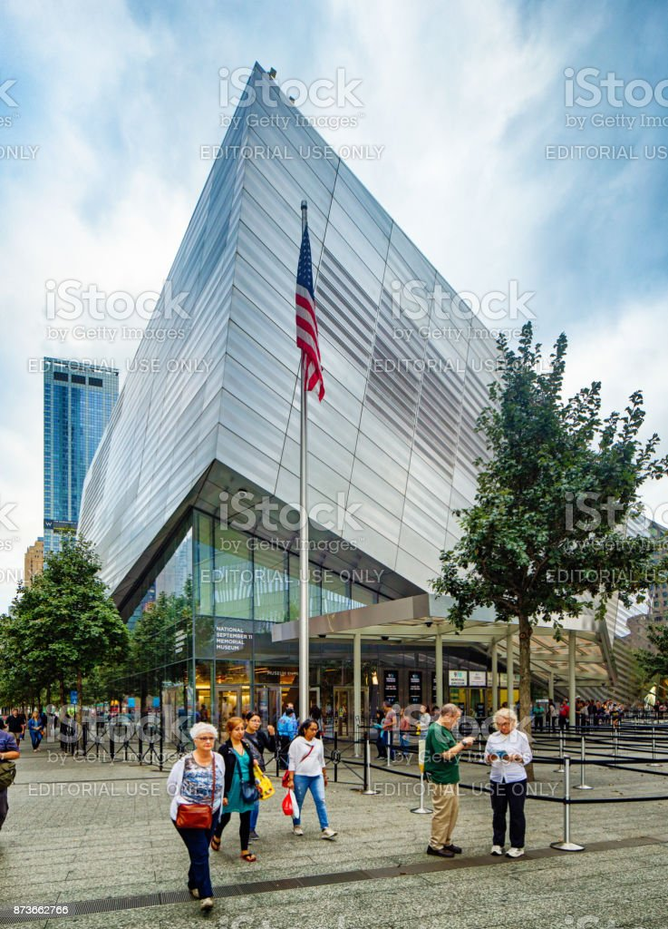 National September 11 memorial museum with American flag and tourists stock photo