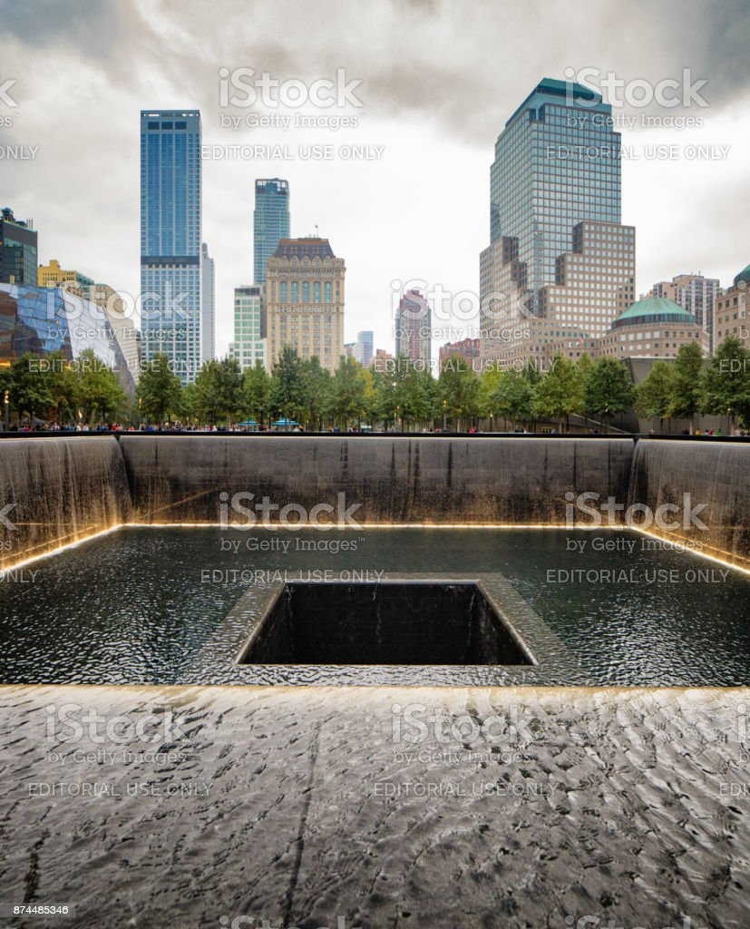 National September 11 memorial waterfalls art with surrounding buildings stock photo