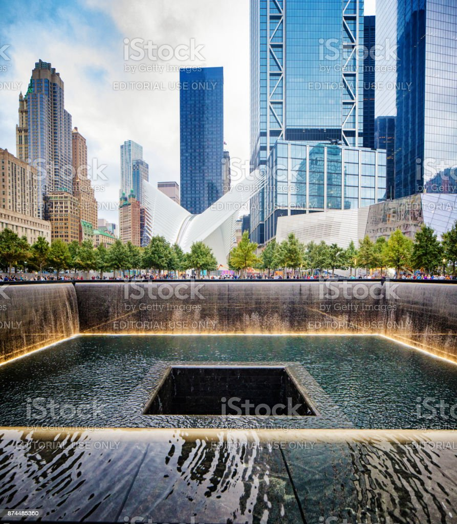 National September 11 memorial waterfalls with Oculus and surrounding buildings stock photo