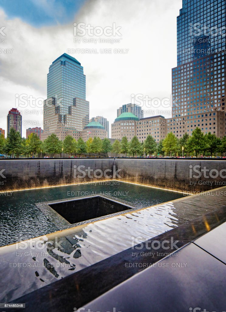 National September 11 memorial waterfalls with surrounding buildings stock photo