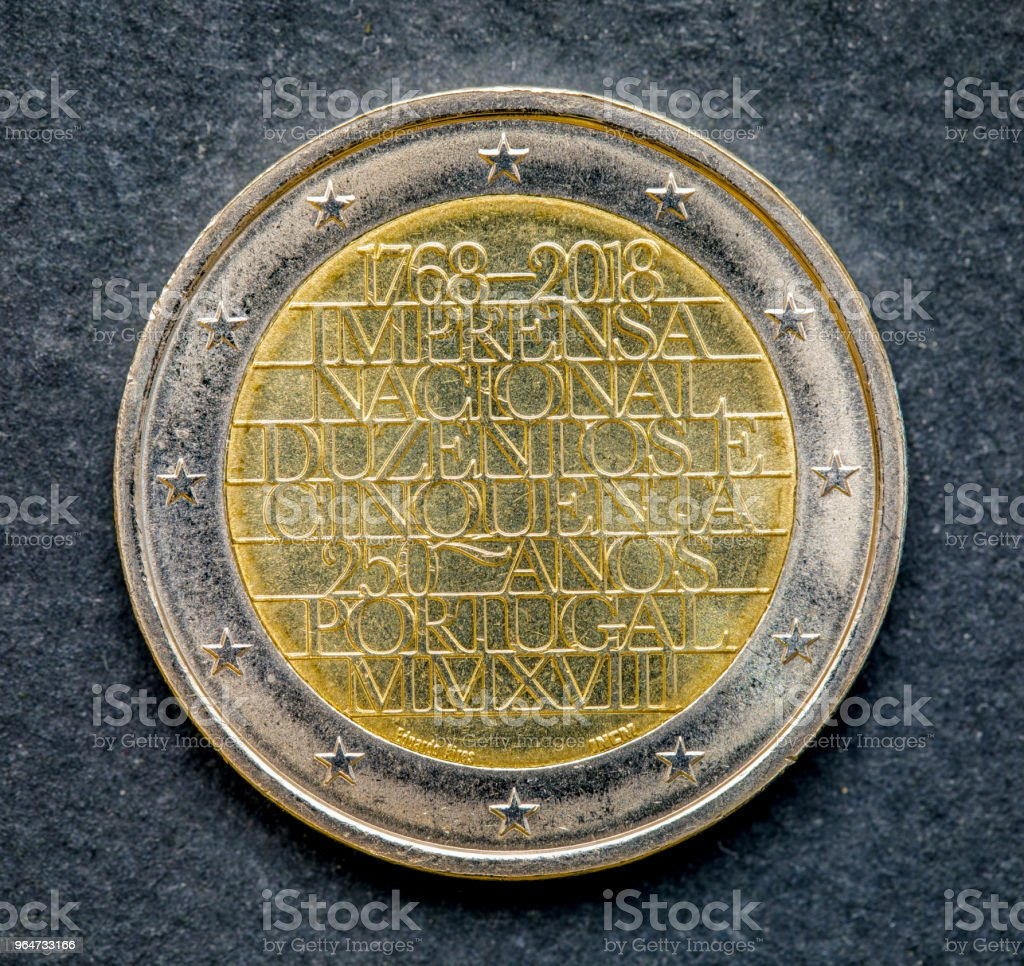 National side of two euro coin issued by Portugal isolated on a black background 2018 royalty-free stock photo