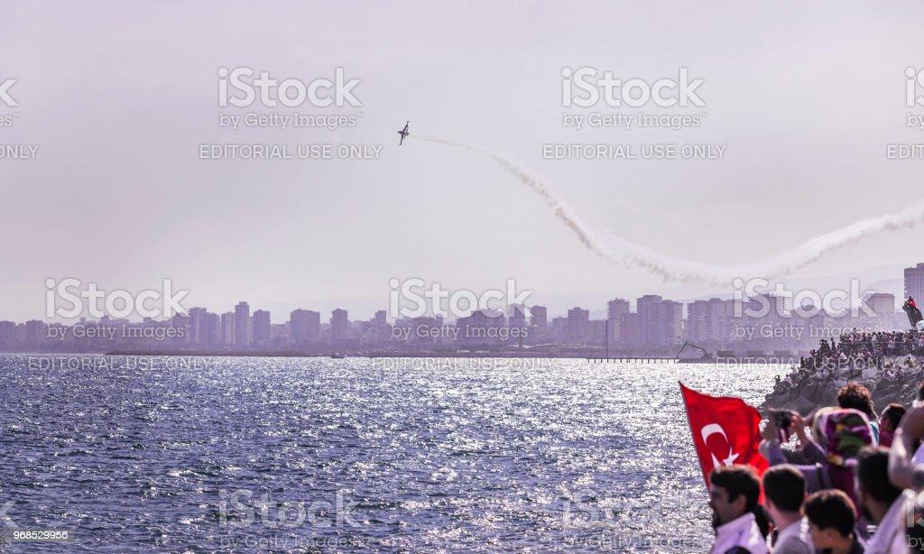 MERSIN, TURKEY - APRIL 23, 2018: National Sovereignty and Children Day festival. Turkish Air Force Demonstration Team Turkish Stars. stock photo