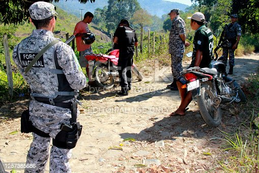pau brasil, bahia / brazil - april 29, 2012: agents of the National Force are seen during patrol in a rural area of the city of Pau Brasil during conflict between indigenous and local farmers.