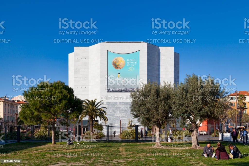 "National Theater of Nice Nice, France - March 26 2019: The National Theater of Nice is a theater located in the city of Nice, in the Alpes-Maritimes. It was built in the Paillon valley, above the course of the coastal river covered by a slab, upstream from Place Masséna.""n Alpes-Maritimes Stock Photo"