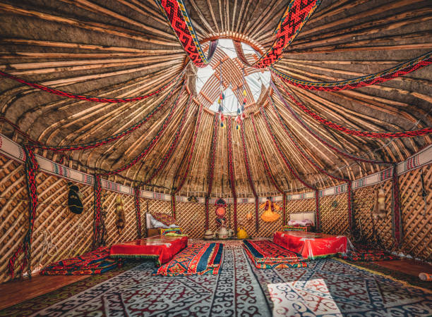National traditional decoration of the yurt ceiling. Kazakhstani ornament. Vintage weaving of patterns. Yurt decoration. Wooden frame with patterns as an ethnic background, golden horde, Kazakhstan National traditional decoration of the yurt ceiling. Kazakhstani ornament. Vintage weaving of patterns. Yurt decoration. Wooden frame with patterns as an ethnic background, golden horde, Photo taken in Kazakhstan. mongolian culture stock pictures, royalty-free photos & images
