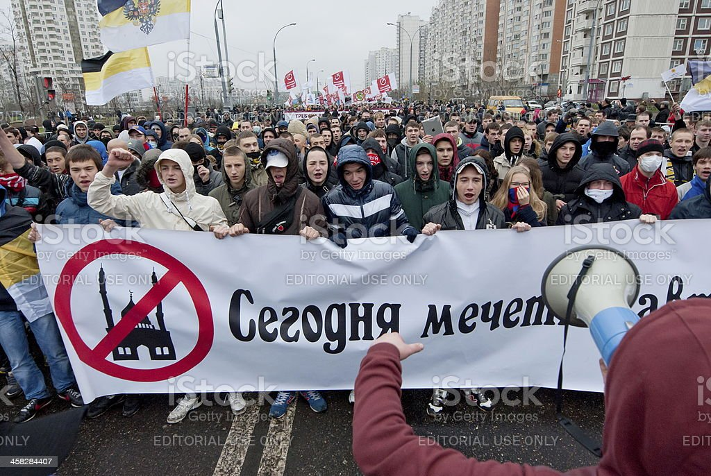 Nationalists hold Anti-Islam banner during 'Russian March' in Moscow, Russia. stock photo