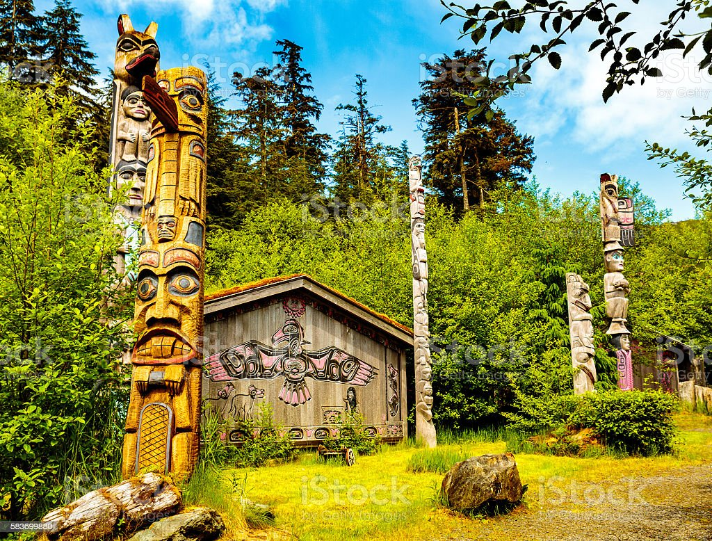 Native American Clan House and Totems stock photo