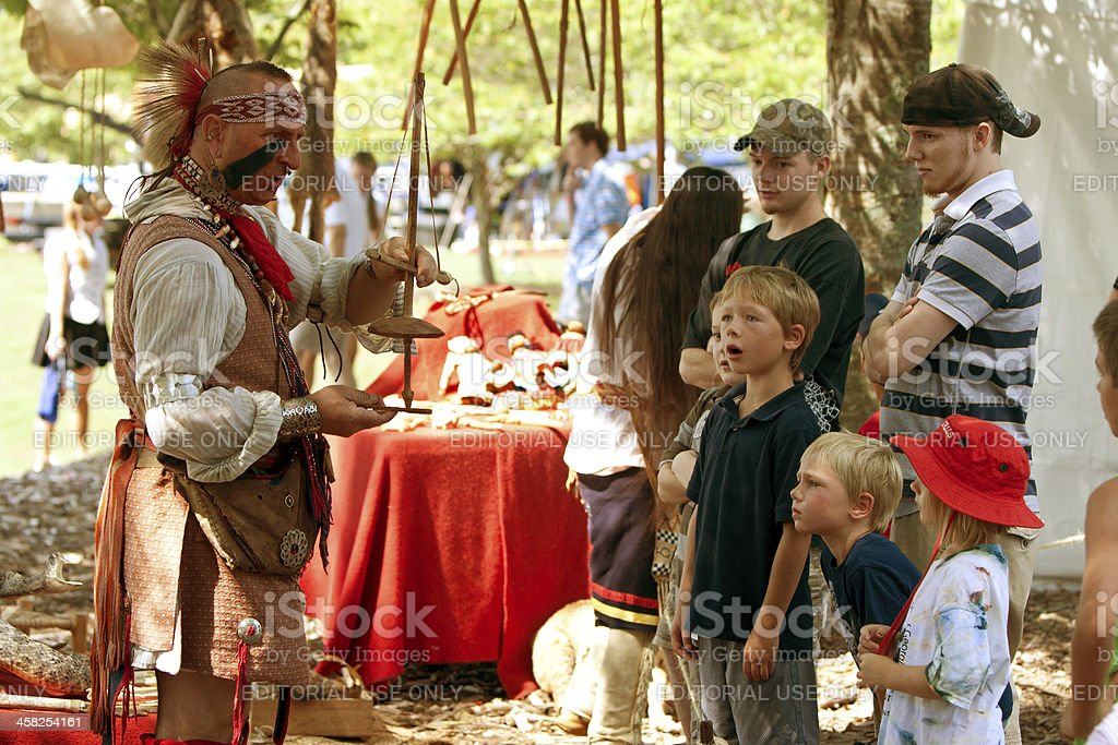 Native American Demonstrates Primitive Tool At Wildlife Festival royalty-free stock photo