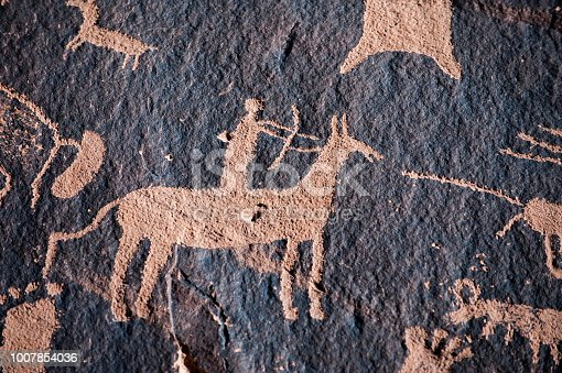 Hunter petroglyph on Newspaper Rock in Canyonlands National Park, Southwest USA