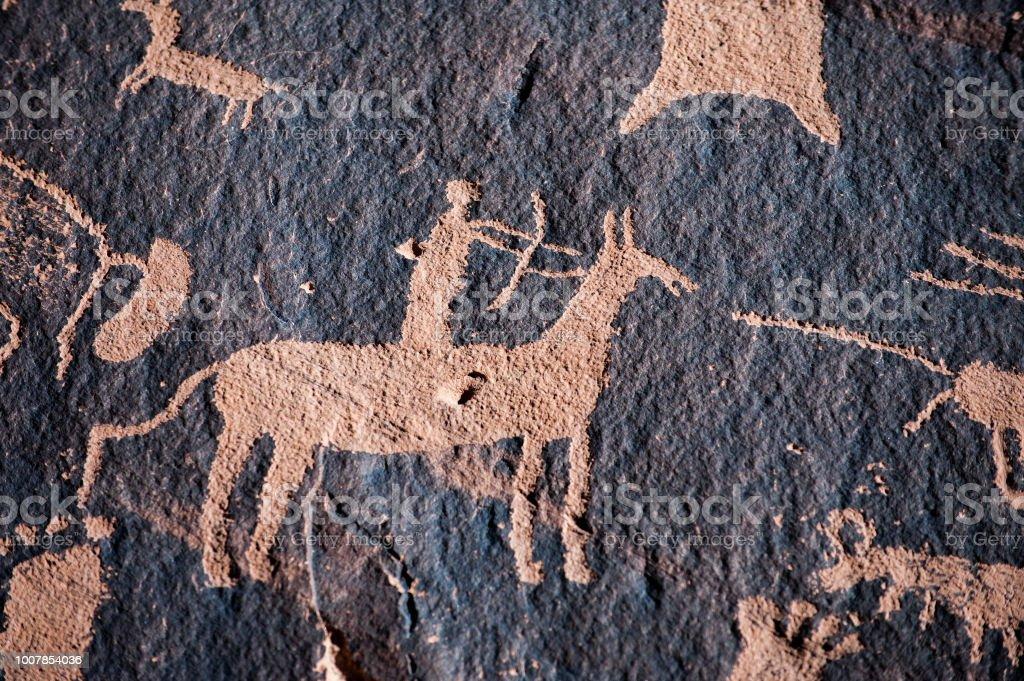 Native american hunter petroglyph stock photo