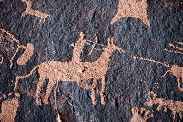 Native american hunter petroglyph Hunter petroglyph on Newspaper Rock in Canyonlands National Park, Southwest USA antediluvian stock pictures, royalty-free photos & images