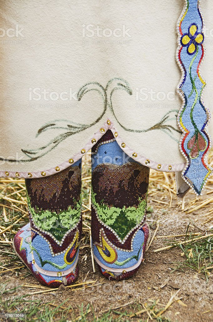 Native American Indian beaded moccasins and dress stock photo