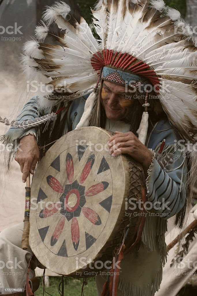 Native American Indian Chief plays a drum stock photo