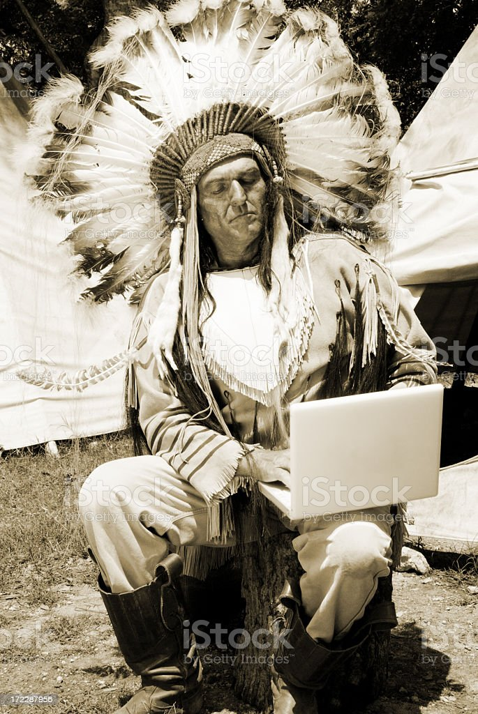 Native American Indian on a laptop royalty-free stock photo